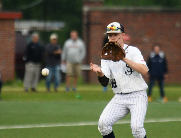 CARL RUSSO/Staff photo St. John's Brady O'Brien fields the ball. Super 8 tourney final: St. John's Prep at North Andover. <br /> <br /> North Andover defeated St. John's Prep in the Super 8 tourney championship game Tuesday night. 6/18/2019
