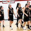 HADLEY GREEN/ Staff photo<br /> Bishop Fenwick players walk back towards their bench after losing to Amesbury at the Bishop Fenwick v. Amesbury Division 3 girls basketball championship game at Wakefield High School on Saturday, March 10th, 2017.