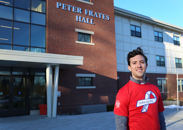 HADLEY GREEN/ Staff photo<br /> Andrew Frates stands outside the Peter Frates Hall at Endicott College. Andrew Frates is running the Boston Marathon for his brother, Pete, who is battling ALS. His training runs often bring him by the Peter Frates Hall at Endicott College.