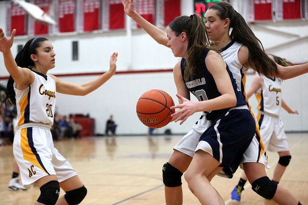 HADLEY GREEN/ Staff photo<br /> Hamilton-Wenham's Kelly Walsh (10) dribbles while Arlington Catholic's Lena Perez (21) and Monica Royo (20) defend her at the Hamilton-Wenham v. Arlington Catholic Division 2 North girls basketball championship finals at Wakefield High School on Saturday, March 10th, 2017.