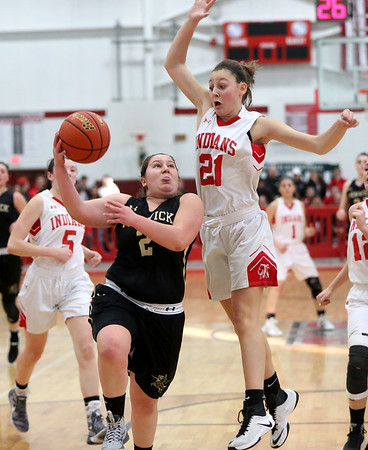 HADLEY GREEN/ Staff photo<br /> Bishop Fenwick's Friederike DeGuglielmo (2) shoots while Amesbury's Allison Napoli (21) plays defense at the Bishop Fenwick v. Amesbury Division 3 girls basketball championship game at Wakefield High School on Saturday, March 10th, 2017.