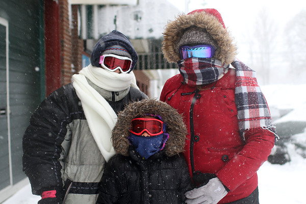 HADLEY GREEN/ Staff photo<br /> From left to right, Tracey, Jaylin, and Temprestt Mello bundle up as they walk through the Salem Willows park towards the ocean during snowstorm Stella on March 14th, 2017.