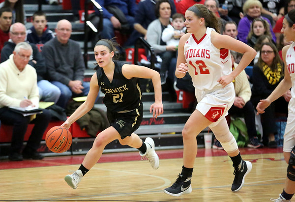 HADLEY GREEN/ Staff photo<br /> Bishop Fenwick's Jaxson Nadeau (21) dribbles down the court while Amesbury's Flannery O'Connor (12) plays defense at the Bishop Fenwick v. Amesbury Division 3 girls basketball championship game at Wakefield High School on Saturday, March 10th, 2017.
