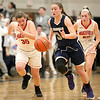 HADLEY GREEN/ Staff photo <br /> Hamilton-Wenham's Elizabeth Kirschner (34) dribbles the ball down the court while Wakefield's Hannah Dziadyk (35) and Allee Purcell (25) run to catch up to her during the Hamilton-Wenham v. Wakefield Division 2 North quarterfinal girls basketball game at Woburn High School on Wednesday, March 8th, 2017.