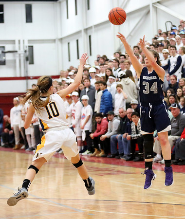 HADLEY GREEN/ Staff photo<br /> Hamilton-Wenham's Elizabeth Kirschner (34) shoots while Arlington Catholic's Alexandra Ball (10) plays defense at the Hamilton-Wenham v. Arlington Catholic 	Division 2 North girls basketball championship finals at Wakefield High School on Saturday, March 10th, 2017.