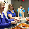 HADLEY GREEN/ Staff photo<br /> Julie Medailleu of Peabody helps serve pasta and chicken at Haven from Hunger in Peabody. Medailleu is a part of the C3 community service group for students of the Community Covenant Church in Peabody.