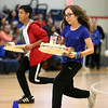 HADLEY GREEN/ Staff photo <br /> Sixth grader Madison Sullivan and seventh grader Ivin Say compete in a healthy-eating themed relay race at the 'March Moo-ves' kick off event at the Collins Middle School in Salem on Tuesday, March 7th, 2017.