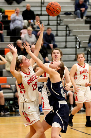 HADLEY GREEN/ Staff photo <br /> Hamilton-Wenham's Cecily Szady (23) and Wakefield's Allee Purcell (25) vie for a rebound during the Hamilton-Wenham v. Wakefield Division 2 North quarterfinal girls basketball game at Woburn High School on Wednesday, March 8th, 2017.