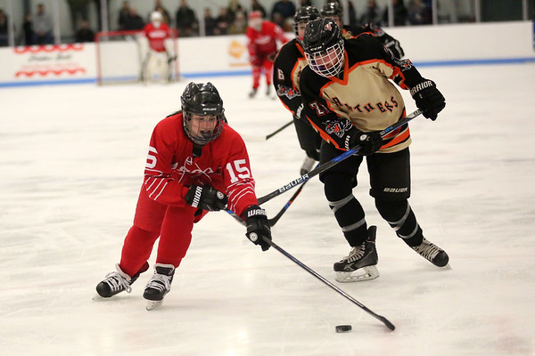 HADLEY GREEN/ Staff photo <br /> With Beverly defense at her heels, Masco's Samantha Kelleher (15) skates towards the goal at the Beverly v. Masco girls hockey game at the Bourque Arena in Beverly on Friday, March 3rd, 2017.