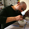 HADLEY GREEN/ Staff photo<br /> Alssaad Fridhi of Lynn paints a bowl at Haven from Hunger in Peabody in preparation for the organization's Empty Bowl Dinner on May 4th. The dinner raises money for Haven's hunger-relief programs.