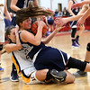 HADLEY GREEN/ Staff photo<br /> Hamilton-Wenham's Kelsie Baker (22) wrestles to keep possession of the ball while Arlington Catholic's Lena Perez (21) challenges her at the Hamilton-Wenham v. Arlington Catholic Division 2 North girls basketball championship finals at Wakefield High School on Saturday, March 10th, 2017.