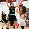 HADLEY GREEN/ Staff photo<br /> Amesbury's Kimberly Croce (3) looks to pass the ball while Bishop Fenwick's Elizabeth Pica (12) plays defense at the Bishop Fenwick v. Amesbury Division 3 girls basketball championship game at Wakefield High School on Saturday, March 10th, 2017.