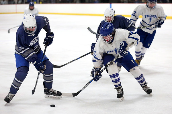 HADLEY GREEN/ Staff photo <br /> Danvers' Jack Thibodeau (11) and Stoneham's Joe Carroll (20) go after the puck at the Danvers v. Stoneham boys hockey playoff game at the O'Brien rink in Woburn on Friday, March 3rd, 2017.