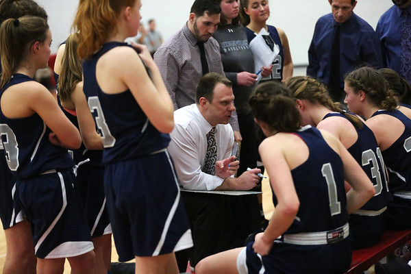 HADLEY GREEN/ Staff photo<br /> Hamilton-Wenham players listen to their coach, Jon DeMarco, during a timeout at the Hamilton-Wenham v. Arlington Catholic Division 2 North girls basketball championship finals at Wakefield High School on Saturday, March 10th, 2017.