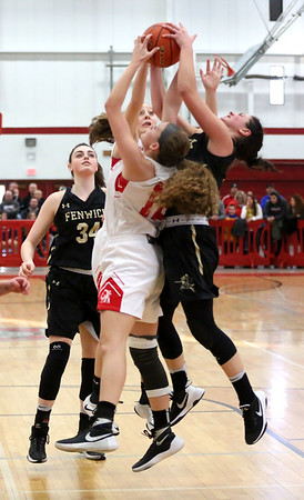 HADLEY GREEN/ Staff photo<br /> Players on both teams vie for the rebound during the Bishop Fenwick v. Amesbury Division 3 girls basketball championship game at Wakefield High School on Saturday, March 10th, 2017.