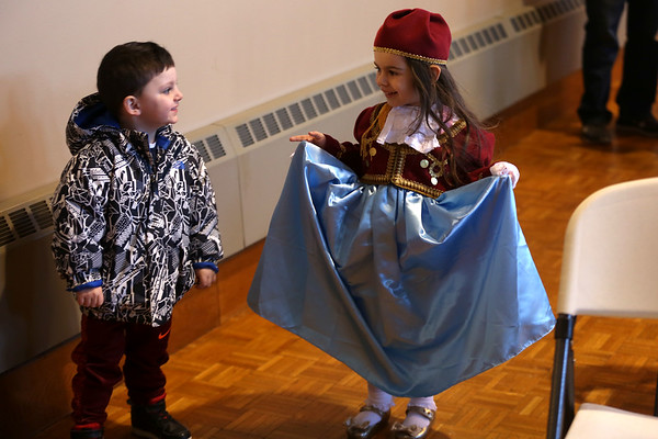 HADLEY GREEN/ Staff photo<br /> Iliana Nirgianakis, 3, shows Costa Nirgianakis, 2, her dress during the St. Vasilios Greek School celebration of Greek Independence Day at City Hall in Peabody on Wednesday, March 22nd, 2017.