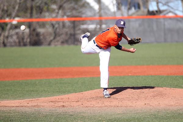 HADLEY GREEN/ Staff photo<br /> Salem State's Jose Martinez (11) pitches at the Salem State v. Wheaton College men's varsity baseball at Salem State University on Thursday, March 30th, 2017.