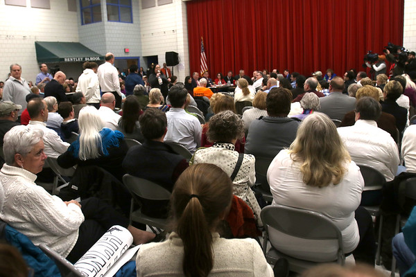 HADLEY GREEN/ Staff photo<br /> The Bentley School's cafetorium was packed for the public hearing regarding Salem's Sanctuary for Peace ordinance on Wednesday evening. People in attendance wore white to show their support for the passage of the ordinance.