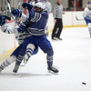 HADLEY GREEN/ Staff photo <br /> Stoneham's Will O'Brien checks a Danvers player at the Danvers v. Stoneham boys hockey playoff game at the O'Brien rink in Woburn on Friday, March 3rd, 2017.