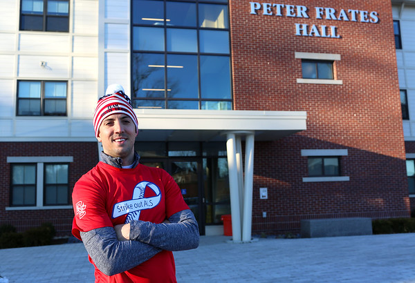 HADLEY GREEN/ Staff photo<br /> Andrew Frates stands outside the Peter Frates Hall at Endicott College. Frates is running the Boston Marathon for his brother, Pete, who is battling ALS. His training runs often bring him by the Peter Frates Hall at Endicott College.