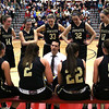 HADLEY GREEN/ Staff photo<br /> Bishop Fenwick players huddle around their coach Adam DeBaggis during a timeout at the Bishop Fenwick v. Amesbury Division 3 girls basketball championship game at Wakefield High School on Saturday, March 10th, 2017.