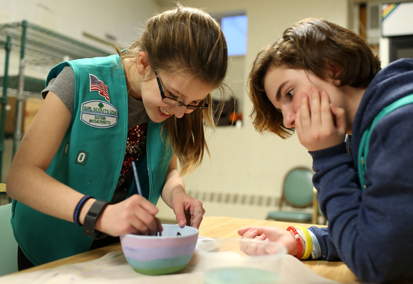HADLEY GREEN/ Staff photo<br /> Girl Scouts Anna Prideaux, left, and Isabel Avila, right, paint bowls at Haven from Hunger in Peabody in preparation for the organization's Empty Bowl Dinner on May 4th. The dinner raises money for Haven's hunger-relief programs.