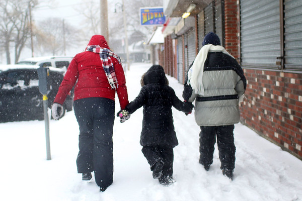 HADLEY GREEN/ Staff photo<br /> From left to right, Temprestt, Jaylin, and Tracey Mello walk through the Salem Willows park towards the ocean during snowstorm Stella on March 14th, 2017.