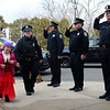 HADLEY GREEN/Staff photo<br /> Salem police salute Dior Stavros, a 6-year-old girl from Salem who has leukemia, as she walks into the Salem Police Department. Dior was sworn in as an honorary police officer by Police Chief Mary Butler, and her family was given a donation from the organization Cops for Kids with Cancer. <br /> <br /> 03/09/18