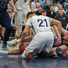 AMANDA SABGA/Staff photo<br /> <br /> St. John's Prep's Tommy O'Neill (11) fights for a lose ball with Lawrence's Jaden Castillo (21) during the D1 North quarterfinals at Lawrence High School. St. John's Prep fell 80-64 to Lawrence.<br /> <br /> <br /> 3/3/18