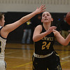 JIM VAIKNORAS/Staff photo Fenwick's Liz Gonzalez drives on Archbishop Williams player Bridget O'Reilly at Woburn high Wednesday night.