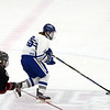CARL RUSSO/Staff photo. Danvers' Calvin Mansfield moves the puck as North Andover's captain, Tyler Buonopane gives chase. North Andover defeated Danvers 5-2 in boys hockey in Division 2 North playoff quarterfinals. 3/01/2018