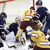 CARL RUSSO/staff photo St John's goalie, Cam Ludwig makes the save as his teammate, captain Tim Usalis clears the puck. St. John's Prep was defeated 1-0 by BC High in Super 8 hockey playoff action. 3/05/2018
