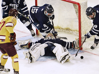 CARL RUSSO/staff photo St John's goalie, Cam Ludwig makes a big save as his teammates clear the puck. St. John's Prep was defeated 1-0 by BC High in Super 8 hockey playoff action. 3/05/2018