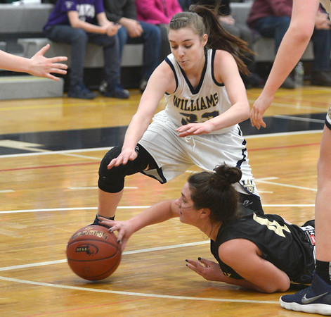 JIM VAIKNORAS/Staff photo Fenwick's Olivia DiPietro rolls a pass after diving for a loose ball against Archbishop Williams at Woburn high Wednesday night.