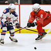 CARL RUSSO/staff photo Methuen/Tewksbury's captain, Kelly Golini and Masco.'s captain Kate Irons fight for the puck. Methuen/Tewksbury girls vs. Masconomet in Div. 1 semifinals. 3/12/2018