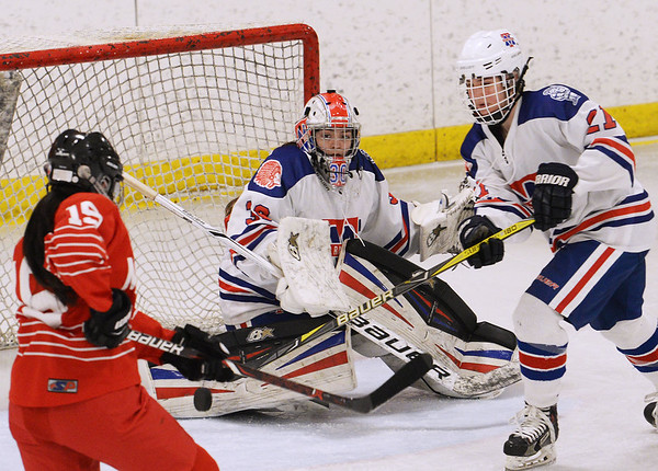 CARL RUSSO/staff photo Methuen/Tewksbury's goalie, Kaia Hollingsworth makes the save as Masco.'s captain, Samantha Kelleher and Methuen/Tewksbury's Madi Sjostedt fight for the puck. Methuen/Tewksbury girls vs. Masconomet in Div. 1 semifinals. 3/12/2018