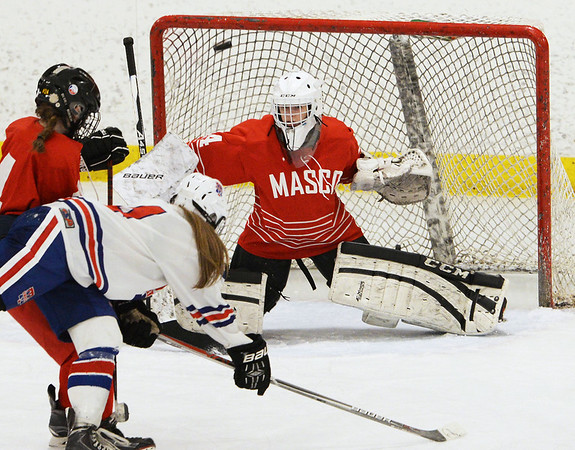 CARL RUSSO/staff photo Masco.'s goalie, Molly Elmore makes the save as Masco.'s Meghan Mc Elaney and Methuen/Tewksbury's Cassidy Gruning fight for position in front of the net.   Methuen/Tewksbury girls vs. Masconomet in Div. 1 semifinals. 3/12/2018
