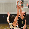 JIM VAIKNORAS/Staff photo Fenwick's Olivia DiPietrot is fouled against Archbishop Williams at Woburn high Wednesday night.