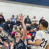 AMANDA SABGA/Staff photo<br /> <br /> St. John's Prep's Tommy O'Neil (11) attempts a falling shot against Lawrence's Jaden Castillo (21) during the D1 North quarterfinals at Lawrence High School. St. John's Prep fell 80-64 to Lawrence.<br /> <br /> <br /> 3/3/18