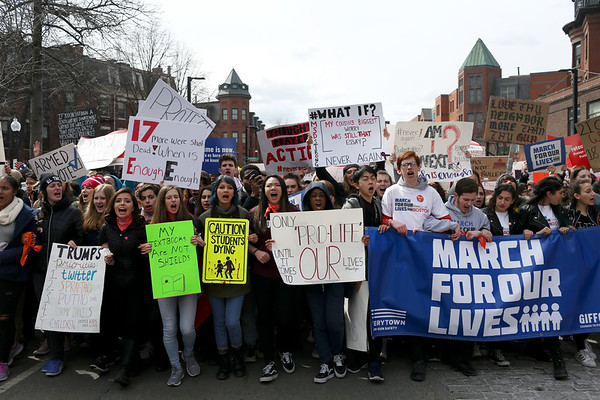 HADLEY GREEN/Staff photo<br /> Students lead the March For Our Lives protest down Columbus Ave in Boston.<br /> <br /> 03/23/18
