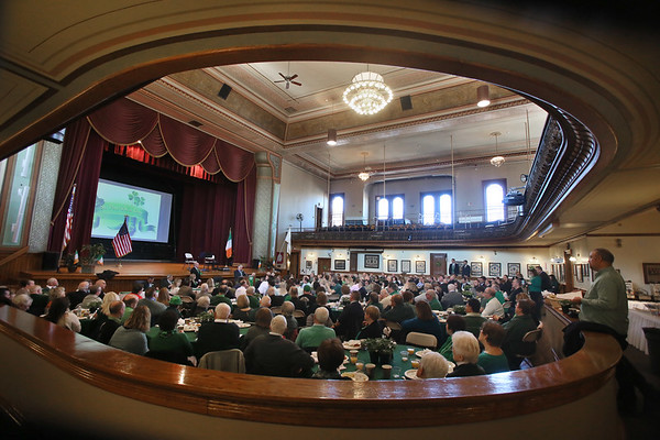 MIKE SPRINGER/Staff photo<br /> A crowd gathers in the Peabody City Hall auditorium Saturday for the annual St. Patrick's Day breakfast.<br /> 3/17/2018