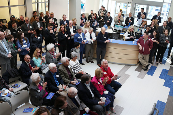 HADLEY GREEN/Staff photo<br /> Guests attend the ribbon-cutting ceremony for the new expansion at the Sterling YMCA in Beverly. <br /> <br /> 03/27/18