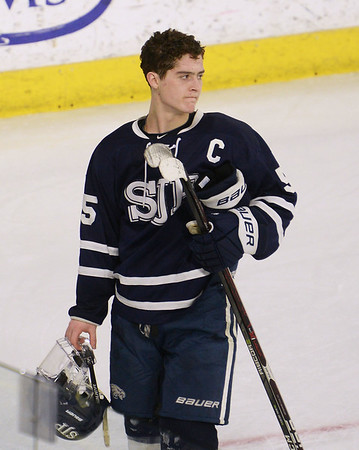 CARL RUSSO/staff photo St John's captain, Matty Tighe is the last to leave the ice. He is looking back to make sure is teammates are all gone. St. John's Prep was defeated 1-0 by BC High in Super 8 hockey playoff action. 3/05/2018