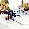 CARL RUSSO/staff photo St John's Zach McKennelley fights for the puck. St. John's Prep was defeated 1-0 by BC High in Super 8 hockey playoff action. 3/05/20188