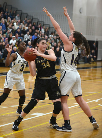 JIM VAIKNORAS/Staff photo Fenwick's Jennie Meagher makes a move on Archbishop Williams player Jess Knight at Woburn high Wednesday night.