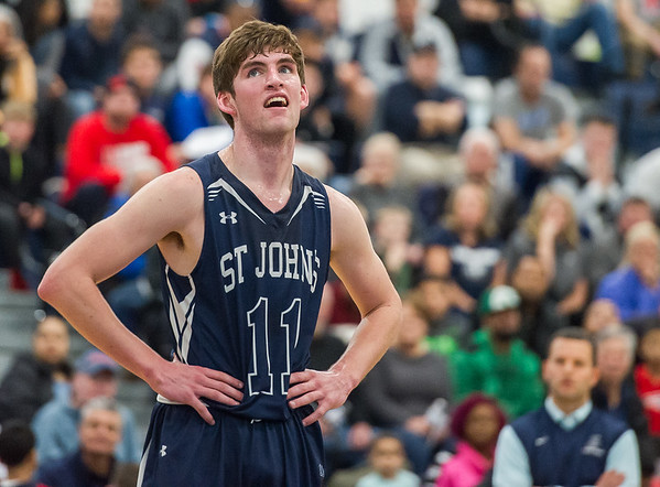 AMANDA SABGA/Staff photo<br /> <br /> St. John's Prep's Tommy O'Neil reacts to a call during the D1 North quarterfinals at Lawrence High School. St. John's Prep fell 80-64 to Lawrence.<br /> <br /> <br /> 3/3/18