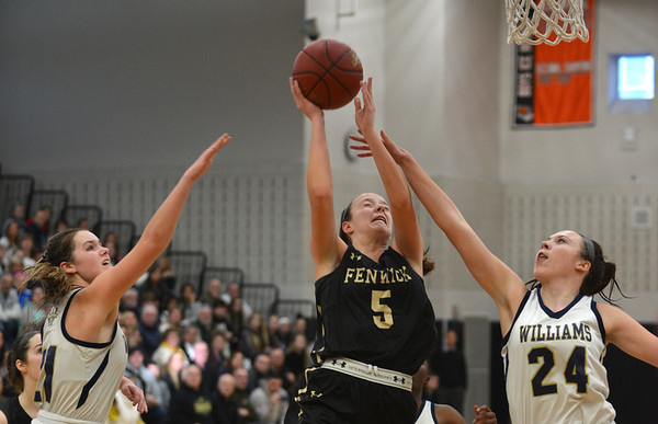 JIM VAIKNORAS/Staff photo Fenwick's Sammi Gallant is fouled against Archbishop Williams at Woburn high Wednesday night.