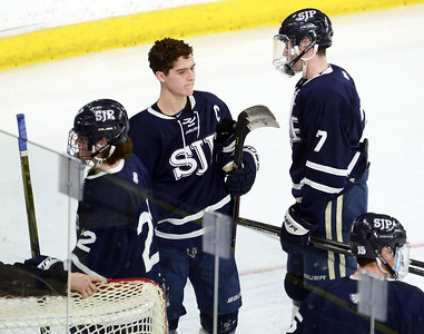 CARL RUSSO/staff photo St John's captain, Matty Tighe, center, is the last to leave the ice. He is looking back to make sure is teammates are all off the ice. St. John's Prep was defeated 1-0 by BC High in Super 8 hockey playoff action. 3/05/2018
