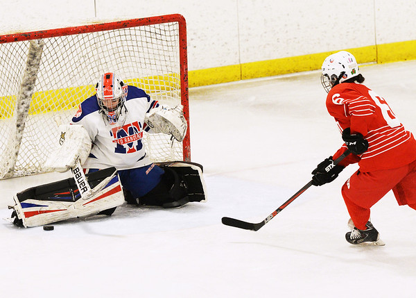 CARL RUSSO/staff photo Methuen/Tewksbury's goalie, Kaia Hollingsworth makes the save on Masco.'s Charisse Flanagan. Methuen/Tewksbury girls vs. Masconomet in Div. 1 semifinals. 3/12/2018