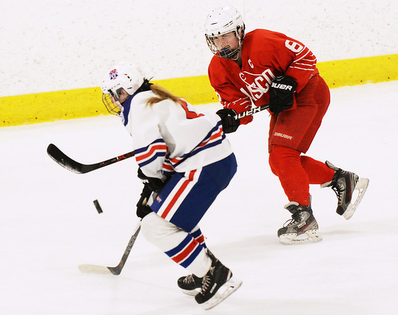 CARL RUSSO/staff photo  Methuen/Tewksbury's Cassidy Gruning and Masco.'s captain, Kate Irons fight for the puck.   Methuen/Tewksbury's girls vs. Masconomet in Div. 1 semifinals. 3/12/2018